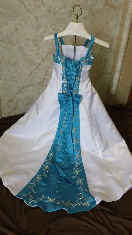 White Miniature Wedding Dress With Turquoise Accents. Design